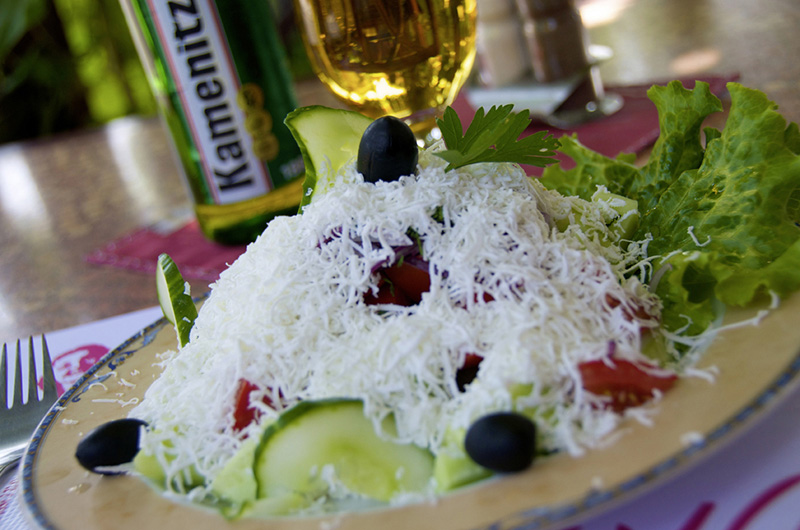 Schopska salad with local beer at restaurant Sunny Beach Bulgaria